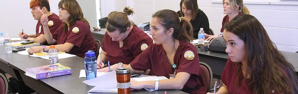 Nursing students take notes in a classroom
