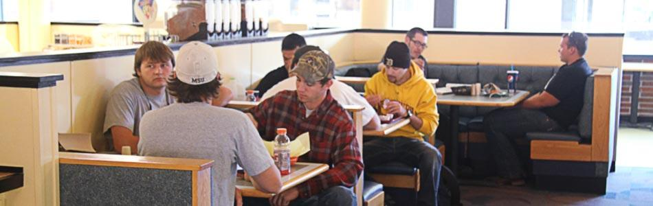 Students eat a meal in a dining hall on MSU Northern's campus